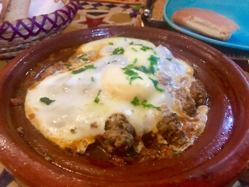 Lamb meatballs with an egg on top